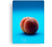 peach on blue background Canvas Print