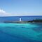 Bahamas Light House  by REINA.L. RESTO