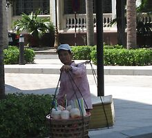 Man selling coconut drink in Ho Chi Minh by MightyMike