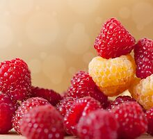fresh bright red and golden raspberry by Arletta Cwalina