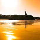 sunset view of the castle beach and cliffs in Ballybunion by morrbyte