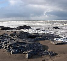 the black rocks on Ballybunion beach by morrbyte