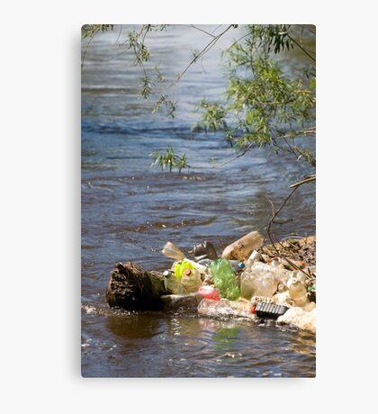 bottles damage river after flood Canvas Print