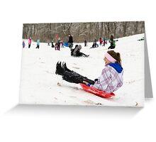 Woman having fun sledding Greeting Card
