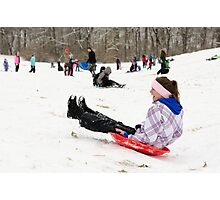 Woman having fun sledding Photographic Print
