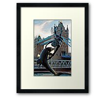 Girl with a Dolfin at Tower Bridge, London, England Framed Print