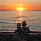 Happiness is enjoying the sunset together by Trine