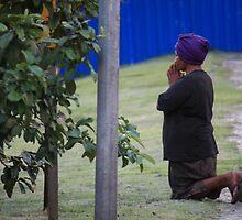 woman praying, rio de janeiro, brazil by nickaldridge