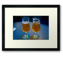 two glasses of beer on an office table Framed Print