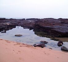 rock pool reflections by Sam Fonte