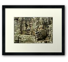 Heads of Stone Framed Print