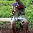 Boy Playing a Flute by Laurel Talabere