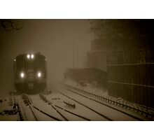 Train entering station during snowstorm Photographic Print