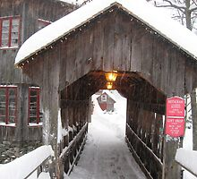 Covered Bridge at the 1760 Old Mill Snowcovered by Rebecca Bryson