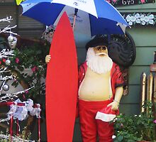 Santa with Surfboard Ready for Rainstorm  by jsmusic