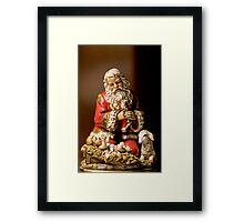 Kneeling Santa Framed Print