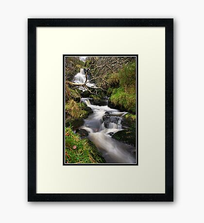 Waterfall and fallen tree Framed Print
