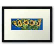 The Sunflowers on blue Framed Print
