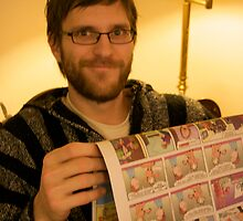 Peter reading the comics by Andrew Boysen