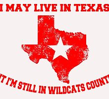 I MAY LIVE IN TEXAS BUT I'M STILL IN WILDCATS COUNTRY by BADASSTEES