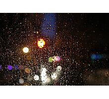 Deatil of raindrops on a car windshield at night Photographic Print