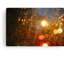 Deatil of raindrops on a car windshield at night Canvas Print