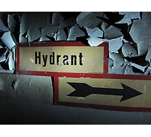 Hydrant sign on a worn out wall with paint peeling Photographic Print