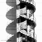 High-contrast spiral stairs. by Paul Wilkin