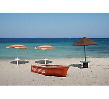 Lifeboat and Three Beach Umbrellas Photographic Print