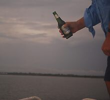 Dad blessing his boat with a beer. by Kristal