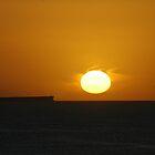 Sunrise at Caves Beach. by Phil Woodman