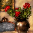 Geraniums on a Table by Mike  Savad