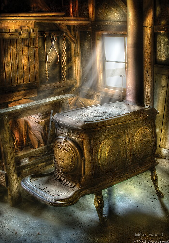 A warm cozy stove by Mike  Savad