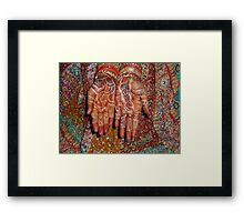 The wonderfully decorated hands and clothes of an Indian bride Framed Print