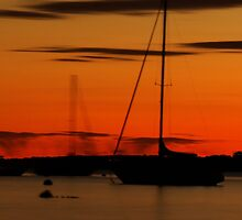 Sailboat Silhouettes at Sunset by Joshua McDonough Photography