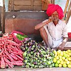 Bundi market vegetable seller by Jeff Barnard