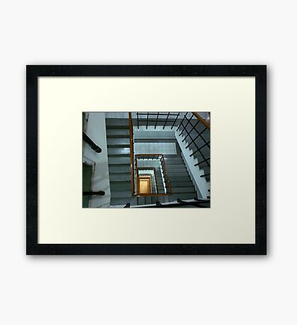 An endless race to the bottom depicted through a staircase Framed Print