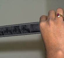 Person holding a strip of photo negatives by ashishagarwal74