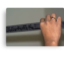 Person holding a strip of photo negatives Canvas Print