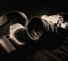 Canon and Nikkormat by Andrew  Makowiecki