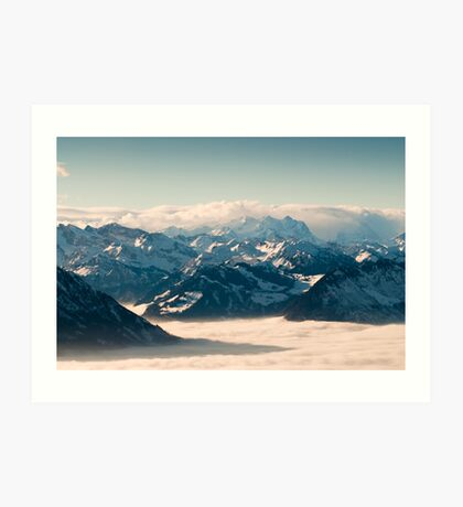 swiss mountains above the clouds in winter Art Print