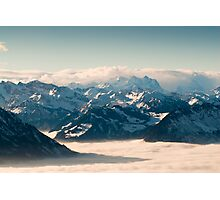 swiss mountains above the clouds in winter Photographic Print