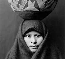 Zuni girl with jar (c.1903). A girl of the Zuni tribe, headcarrying a Native American pottery jar, in New Mexico by Edward S. Curtis. by Adam Asar