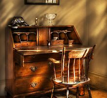 A chair and a desk by Mike  Savad