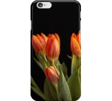 Orange tulips against black background iPhone Case/Skin