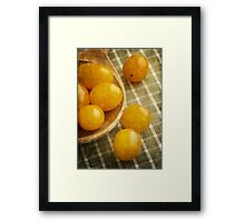 Yellow plum tomatoes on a wooden spoon Framed Print