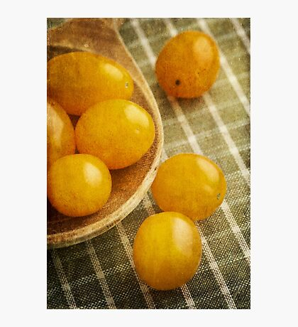 Yellow plum tomatoes on a wooden spoon Photographic Print