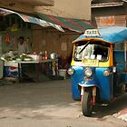 Tuk tuk and street vendor by hellsbell