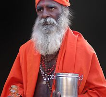 SADHU IN ORANGE by Michael Sheridan