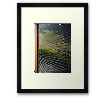 A world in a window Framed Print